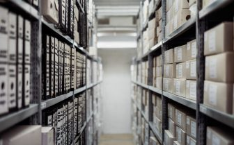 A photo of a storage room with stacks of files