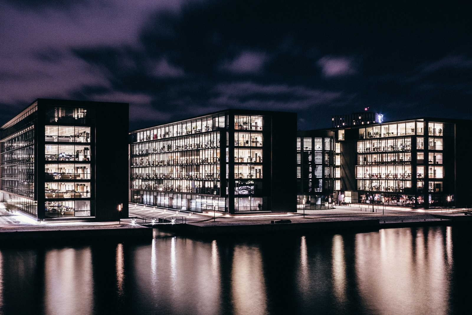 A photo of several lit buildings at night
