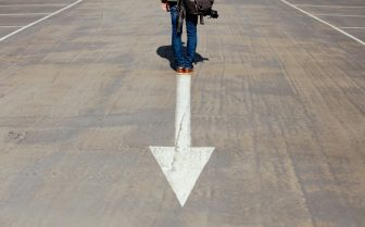 A photo of a white arrow painted on the road